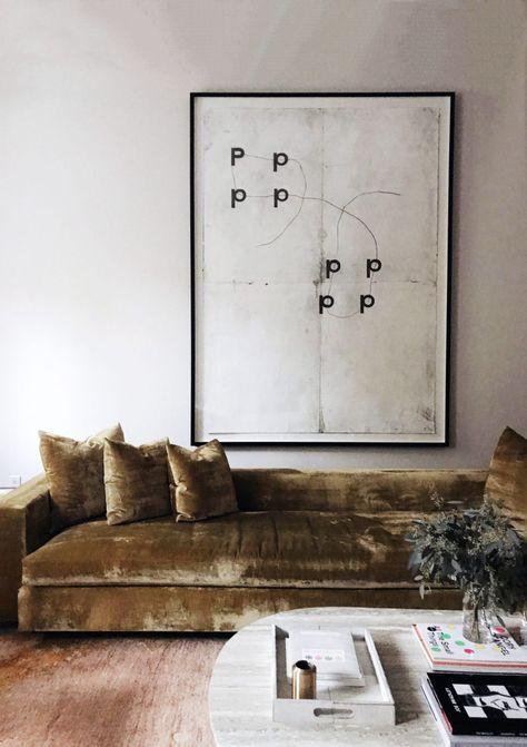 oversized framed art print with gold velvet sofa via colin king. #colinking #sofa #velvetsofa #velvetcouch #print #artprint #framedart #oversizedart