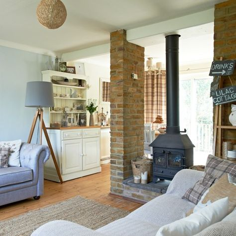 Create an open-plan living area by keeping the existing chimney breast frame and install a log burning stove. It will create a wonderfully cosy centre-piece and will heat the whole area.