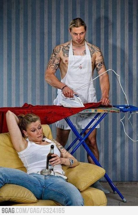 This photo displays reverse gender roles. Its commonly thought that women do the cooking and cleaning, while the men work and when they arrive home, they kick back and relax. This photo is a clear gender role switch.