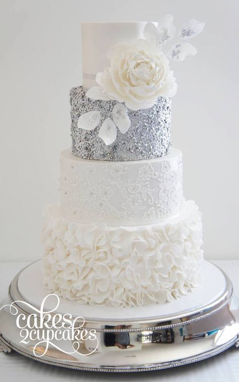 Silver and white wedding cake with flower accent & Sequin Wedding Cakes with metallic gold and silver accents via The Magazine