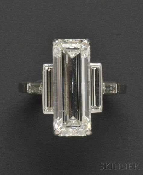Jewelry Diamond : Image Description Platinum and Diamond Ring, Cartier, set with an emerald-cut diamond measuring approx. x x mm, and weighing approx., flanked by baguette-cut diamonds Art Deco Ring, Art Deco Diamond, Art Deco Jewelry, Jewelry Gifts, Fine Jewelry, Jewelry Design, Emerald Cut Diamonds, Diamond Cuts, Diamond Rings