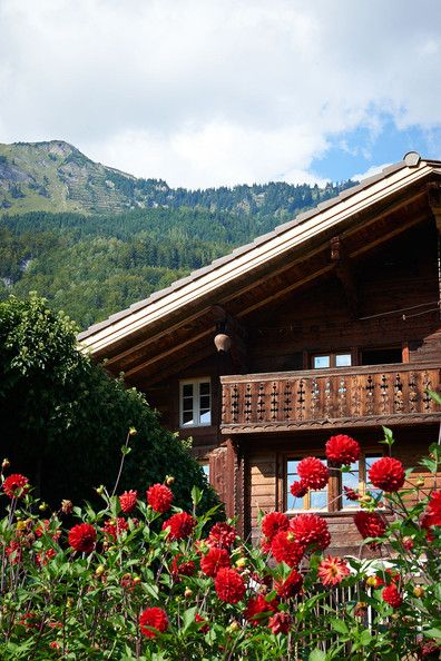 Country Rustic Traditional Landscaping: Exterior view of Chalet with Mountains.