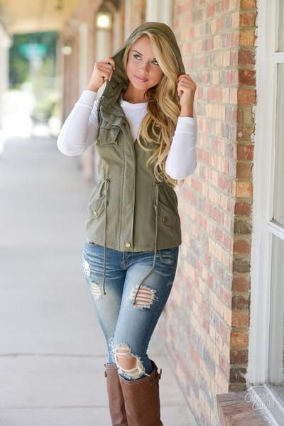 Gear up for colder weather! You'll be as stylish as you are warm in this lovely cargo vest! Army green, cargo style vest with multiple pockets, detachable hood,
