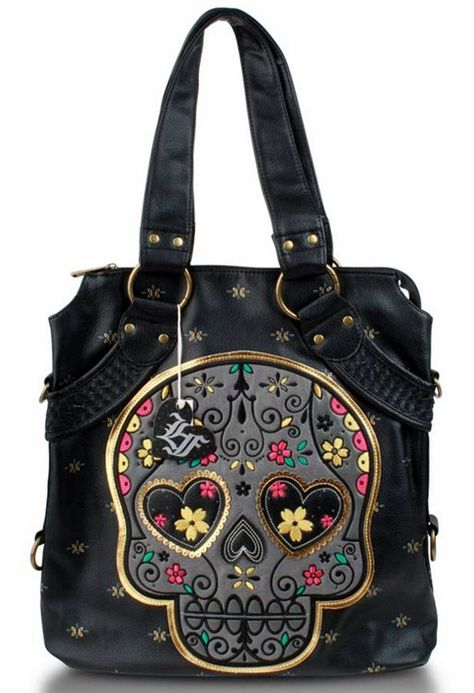 Another super cute Loungefly skull day of the dead purse and has matching wallet I want.