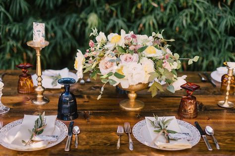 Romantic tablescape with gold footed centerpieces + olive sprig decor