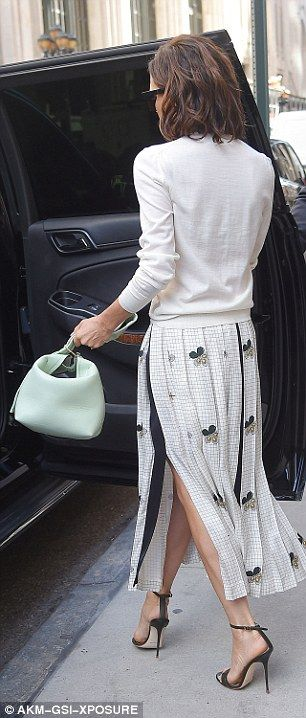Victoria Beckham wearing a jumper & skirt from her Spring / Summer 2017 collection.