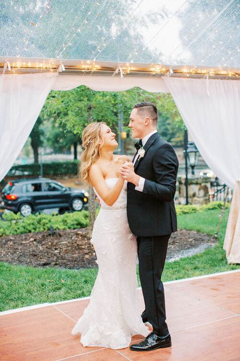 Audrey and Brooks share their first dance under thousands of twinkling lights and their clear top tent. Audrey's mermaid dress sways in the picture and the two look so madly in love. They also rented out the hardwood dance floor from @cerental. Follow us for more wedding day inspiration! #firstdance #wedding #tent Photography by Rachel Elisabeth Photography