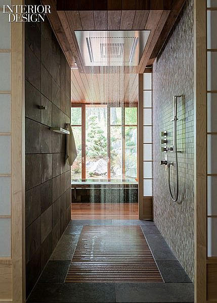 Capturing the Great Outdoors: A Japanese Bathhouse in the Mountains of Montana   A shower runs between the changing room and soaking tub. #design #interiordesign #interiordesignmagazine #architecture #bathroom #shower