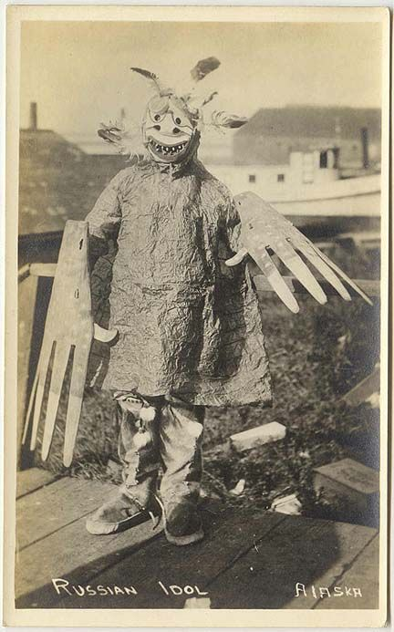Rare Alaska postcard of a Yup'ik Eskimo in shaman's outfit.