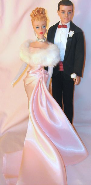 Vintage Barbie Enchanted Evening #983 (1960-1963)    Strapless Pink Satin Gown  White Fur Stole with Pink Lining  Long White Gloves  Triple Strand Pearl Choker with 2 Pearl Drops  Pearl Drop Earrings  Clear Open Toe Heels with Gold Glitter    You've just got to love this classic vintage ensemble with the elegant pink satin strapless gown and the white rabbit fur stole lined in matching pink satin.