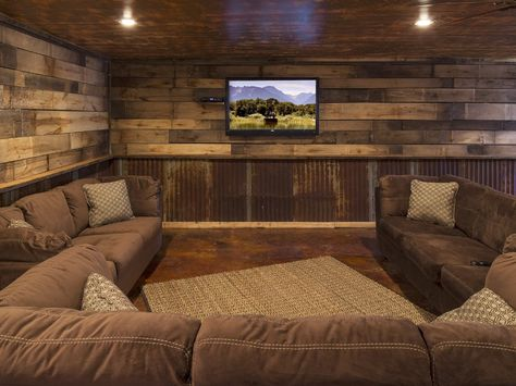 Cozy, rustic home theater. Oh man if I had this room I would never leave my house!