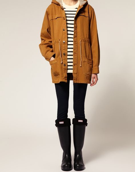 Striped shirt, parka, and Hunter boots.