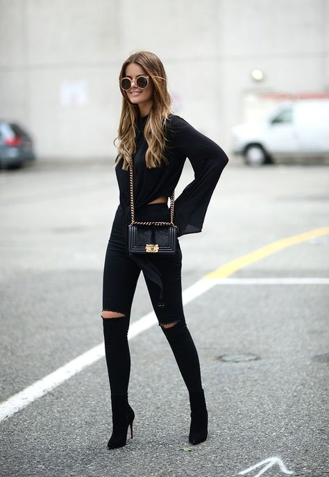 "justthedesign: ""Nette Nestea is looking fierce in this all black outfit of black jeans and an open-slit tee! Top: H&M, Bag: Chanel, Jeans: Topshop, Shoes: Christian Louboutin """