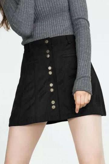 Bring your game this season in this totally fierce black A line skirt. With a bang on trend button down front this artificial suede skirt will give you a killer silhouette. Team with black bralet and strappy heels for chic look.