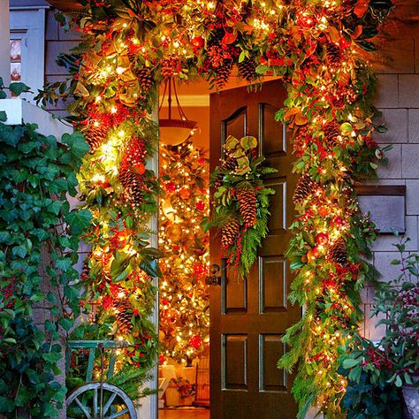 This large, leafy garland and matching front door decorations are made from evergreen branches, pinecones, berries, apples, magnolia leaves, and festive holiday ribbon: http://www.bhg.com/christmas/outdoor-decorations/front-door-christmas-decorating-ideas/?socsrc=bhgpin121714gardeninspiredchristmasdoordecor&page=12