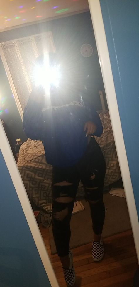 Blue champion hoodie, black ripped jeans, checkered slip on