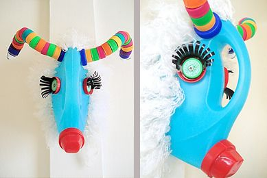 A mounted whoozawhatsit made out of old laundry soap bottle and lids