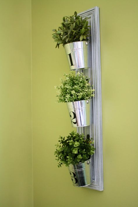 room*6: Vertical Hanging Buckets using an old cabinet door for the backer.