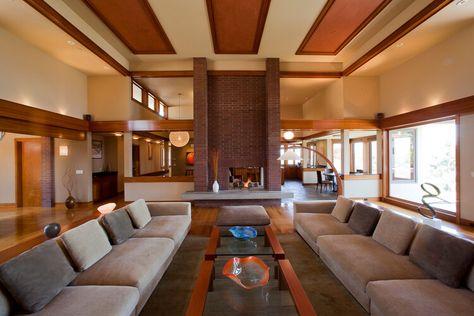Prairie style modern luxury home living room design. #luxuryhomes #lagunahillshomes #lagunahills #modernarchitecture #modernhomes #westcoastlifestyle #interiordesign #californialifestyle #moderndesign #resortstyleliving #mansions #texturedwalls #prairiestylehome #prairiestylearchitecture #prairiestyledesign #livingrooms #greatrooms #highceilings #fireplaces #modernfireplaces #brickfireplaces #couches #sofas