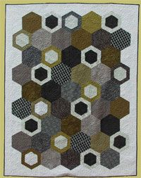 Hey Jude Quilt Pattern by Abbey Lane Quilts at KayeWood.com. Oversized hexagons with smaller raw-edged hexagons scattered help create this modern beauty.  Rich, deep colors give it a great masculine feel. http://www.kayewood.com/item/Hey_Jude_Quilt_Pattern/2898 $10.00