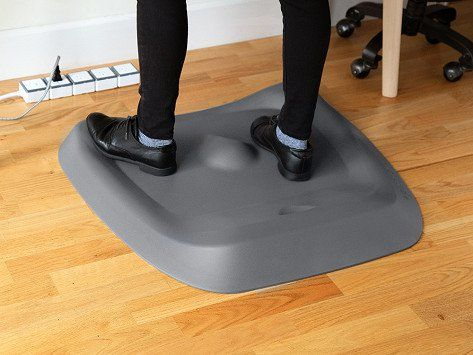 This Cushiony Standing Desk Mat Has A Variable Surface With Bumps Lips And Curves To Keep Feet And Legs Busy Thr Standing Desk Mat Desk Mat Diy Standing Desk