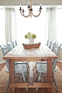 dining room with painted chairs and a diy farm table (using Ana White's farmhouse table plan) and a jute rug