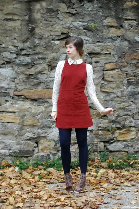 this red jumper dress, lace blouse, navy tights and brown lace up booties.