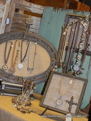 Mimi-Toria's Designs - this is actually my old display from 2009 while selling at the Junk Bonanza.  Found it on pinterest so thought I share it here.  Burlap inside vintage frames, shutters, vintage shed door, and lions claw bathtub foot for displays.