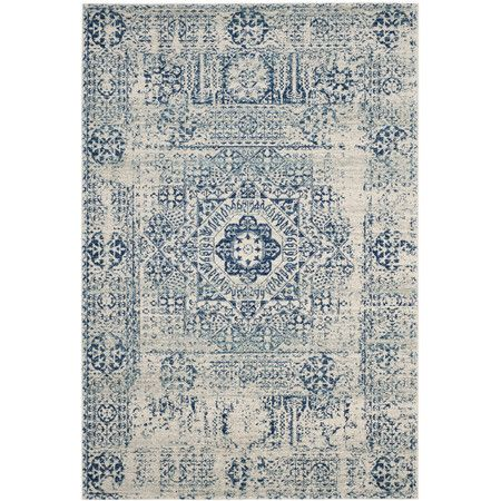 A spectacular fusion of fashion-forward pattern, color and texture, Evoke frieze rugs by Safavieh are soft and casual. Power-loomed of high-twist polyprop...