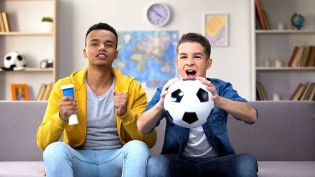 Similar Images To 286727894 Excited Black Guy Watching Sports On Tv At Home In 2020 Soccer Fans Football Team Soccer