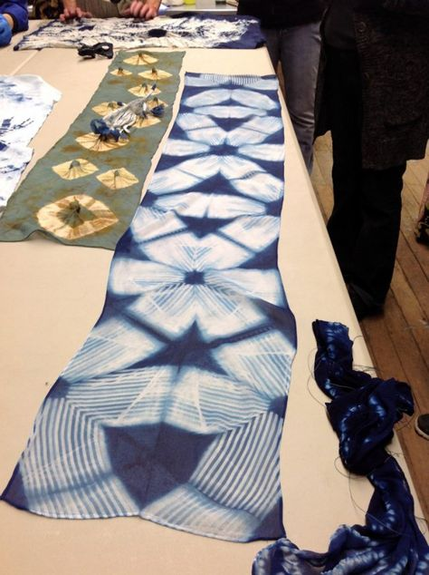 check out this website. shibori itajime technique- using grooved wood blocks resists