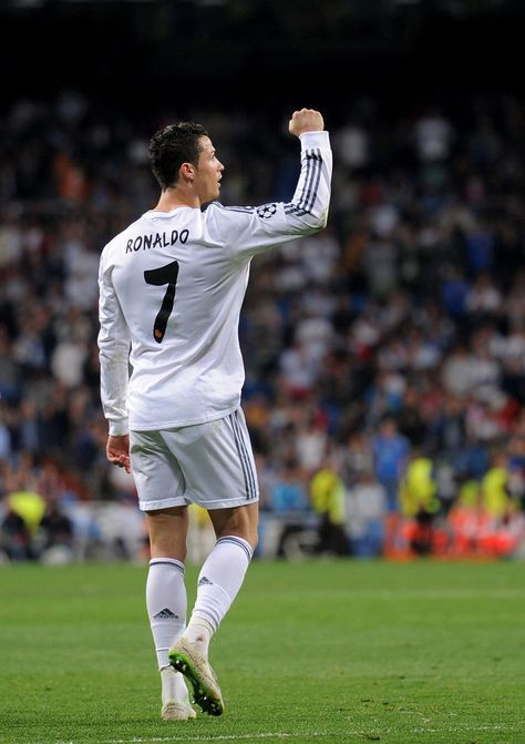 Cristiano Ronaldo celebrates after scoring his team's second goal during the UEFA Champions League round of 16, second leg match between Real Madrid CF and FC Schalke 04 at Estadio Santiago Bernabéu on March 18, 2014 in Madrid, Spain.