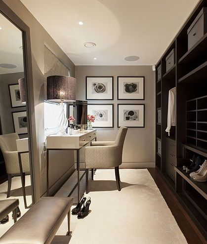 dressing room. Shelf / wardrobe along one side and large recessed mirror along the other