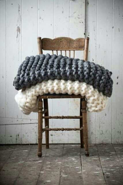 chunky knit blankets, perfect way to invite snuggling ;)Loved by Woadden Nash Interiors