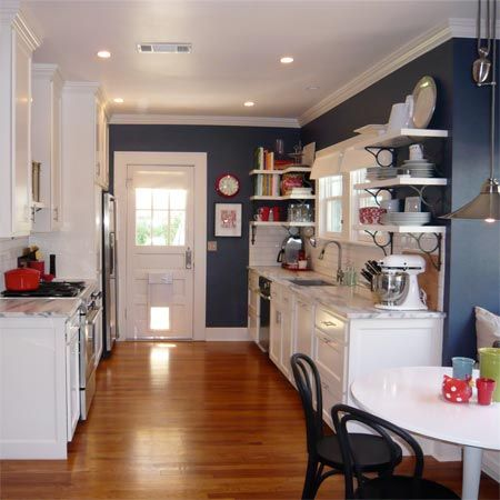 Kitchen: navy blue walls, white cabinets, wood features...love ...