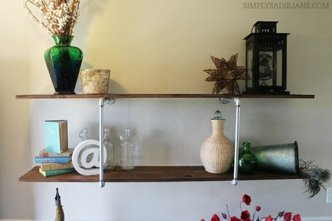 #DIY industrial piping shelves. Add the perfect shabby chic touch to any room using this tutorial.