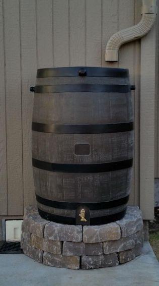 Stone stand for rain barrel