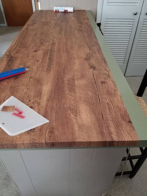 How I Updated a Countertop with Wood-Look Contact Paper & Postcards from the Ridge Source. The post How I Updated a Countertop with Wood-Look Contact Paper appeared first on Claire Layton Interiors. Cheap Countertops, Wood Countertops Kitchen, Kitchen, Diy Kitchen Countertops, Updated Kitchen, Diy Kitchen, Diy Countertops, Wood Diy, Contact Paper
