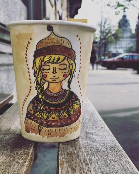 My Friend Paints On Paper Cups Using Coffee