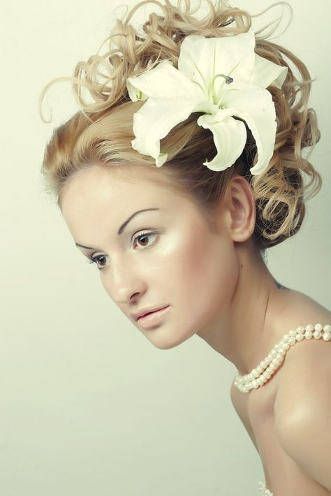 Girl with a flower in her hair #weddinghairstyles