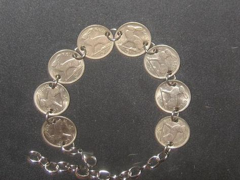 """You are looking at an authentic vintage Irish rabbit adjustable bracelet.Each coin measures about 18mm or the size of a dime.It will fit 8"""" to 10"""" ankle.I can make any size.Stainless steel jump rings,clasp and extender are used. It is reversible with a harp on the other side.I import these coins directly from Ireland. The coins are in good condition and silver color.The years vary in the 1960's.Earrings can be ordered."""
