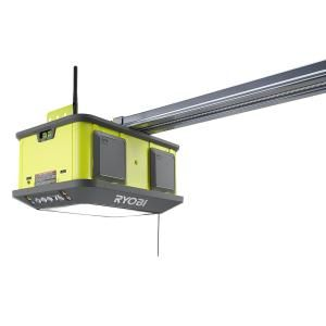 Ryobi Introduces The Quiet Compact 1 1 4 Hp Belt Garage Door Opener The Ryobi Quiet Compact 1 1 4 Hp Garage Door Opener Residential Garage Doors Garage Doors