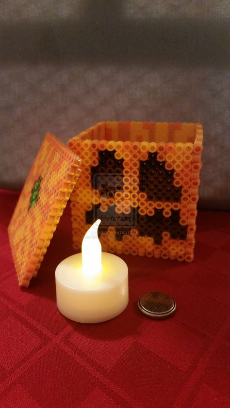 This Minecraft pumpkin is made entirely of perler beads and even lights up! This Minecraft pumpkin is made entirely of perler beads and even lights Perler Bead Designs, Diy Perler Beads, Pearler Bead Patterns, Perler Bead Art, Perler Patterns, Pearler Beads, Fuse Beads, Hama Beads Coasters, Quilt Patterns