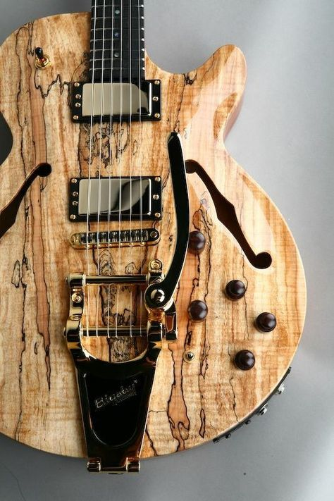 The back is made from a large slab of one-piece mahogany routed out to leave quite a complexly carved centre section. With its dual humbuckers, three-way toggle and tune-o-matic-style bridge/ stud tailpiece set-up, it sticks to a Les Paul control layout, aside from the seemingly complex array of additional controls and sizeable side-plated socket plate that holds two 6.4mm jacks and a 13-pin DIN.  Not only do we have piezo saddles, courtesy of Graph Tech's Ghost system, but also synth access.
