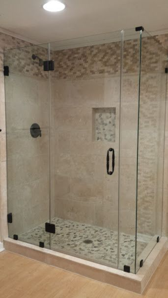 Neutral Earth Tone Bathroom And Shower Stall With Clear Glass