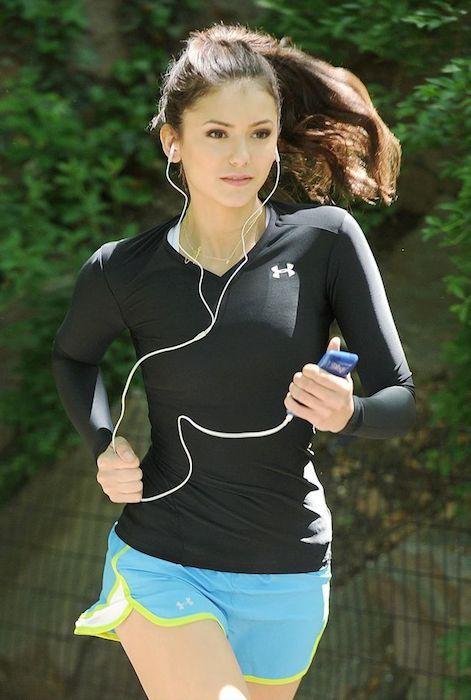 Actress Nina Dobrev working out...