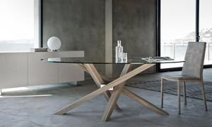 The Stunning Shangai Glass Dining Table Features An Asymmetrical