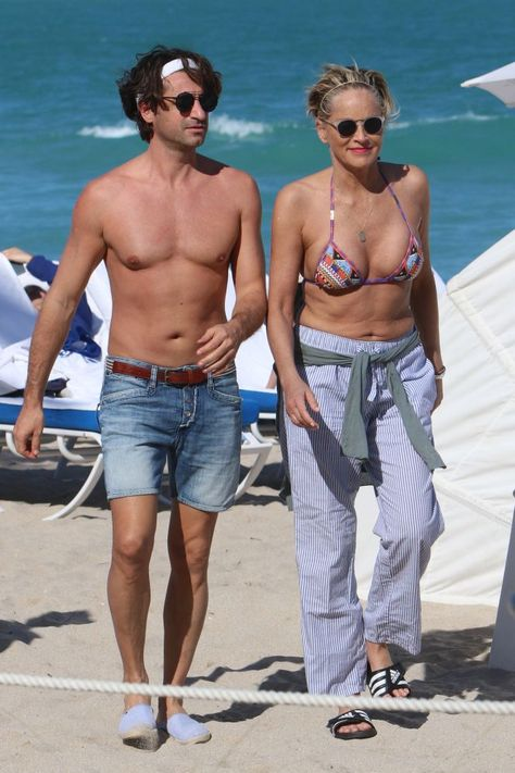Sharon Stone celebrates 60 in a bikini with PDA-loving boytoy