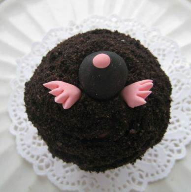 A mole cupcake by Cameo Cupcakes. Look what Cait will be making this weekend!