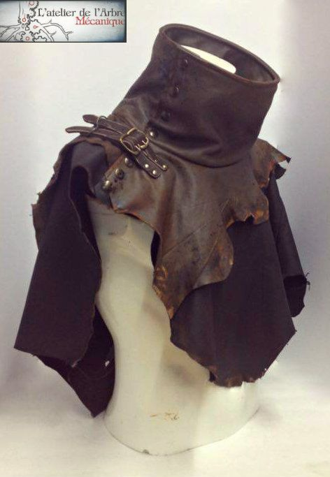 Beautiful cape with a high collar made from scraps of brown